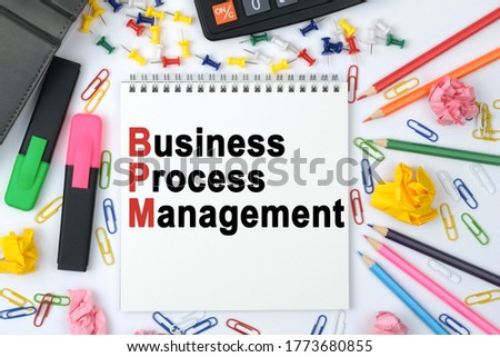 Business concept. On the table is a calculator, diary, markers, pencils and a notebook with the inscription - Business Process Management