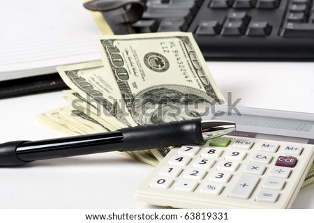 Business concept. Pen, dollars; calculator on white background