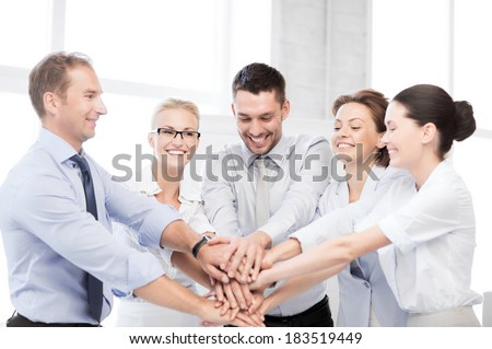 business concept - picture of happy business team celebrating victory in office