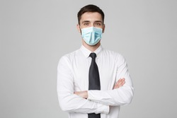 Business Concept - Portrait Handsome Businessman in face mask holding hands with confident face. White Background.