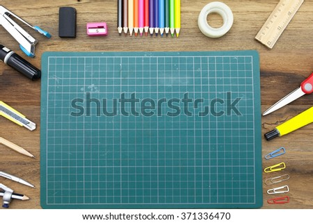 Business concept:stapler,glue,scissor,cutter,tape,pen,pencil,clip,ruler,rubber, cutting mat,divider,sharpener and color pencil on wooden background.Top view