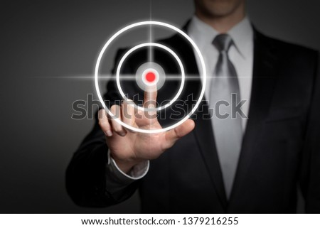 business concept - successful businessman presses virtual touchscreen symbol - hit the target