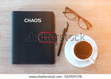 Business concept - Top view notebook cover writing CHAOS