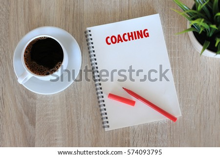 Business concept - Top view notebook writing Coaching