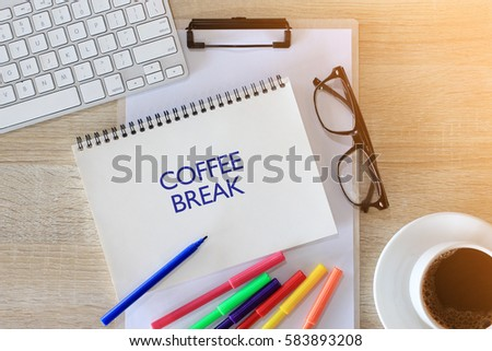 Business concept - Top view notebook writing COFFEE BREAK