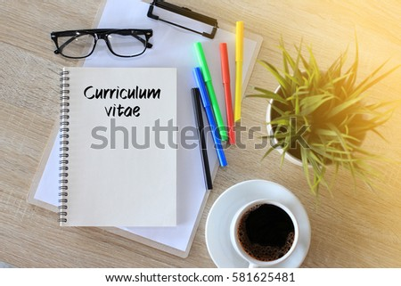 Business concept - Top view notebook writing Curriculum Vitae
