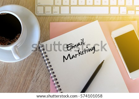 Business concept - Top view notebook writing Email Marketing