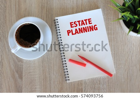 Business concept - Top view notebook writing Estate Planning