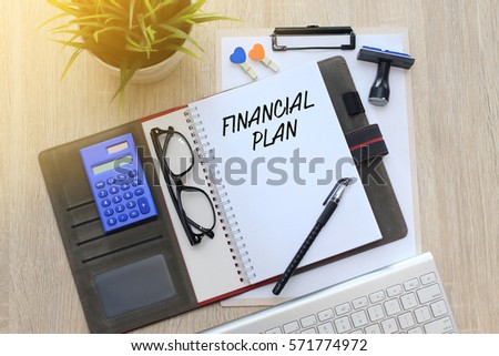 Business concept - Top view notebook writing Financial Plan