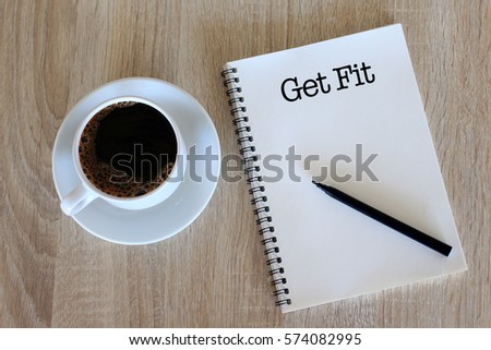 Business concept - Top view notebook writing Get Fit