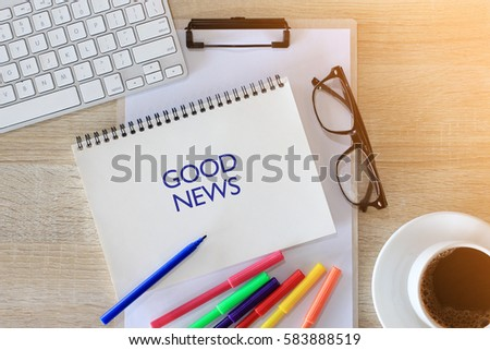 Business concept - Top view notebook writing GOOD NEWS