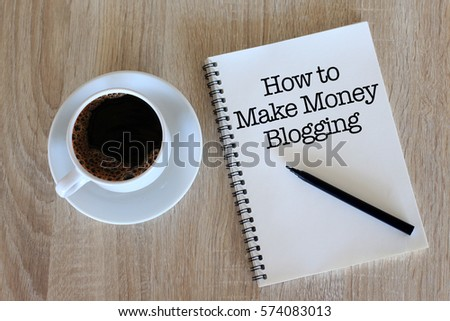 Business concept - Top view notebook writing How to make money blogging