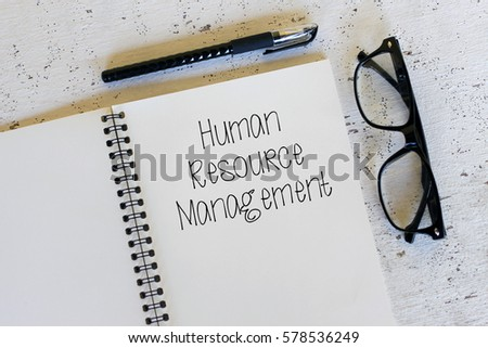 Business concept - Top view notebook writing Human Resource Management