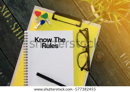 Business concept - Top view notebook writing Know the Rules