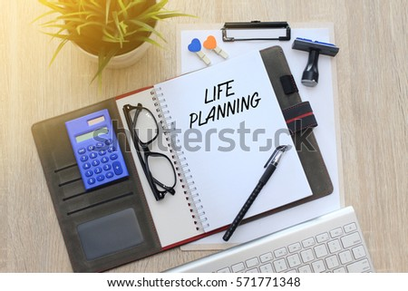 Business concept - Top view notebook writing Life Planning