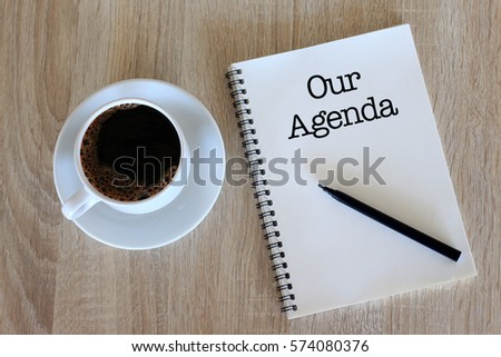 Business concept - Top view notebook writing Our Agenda