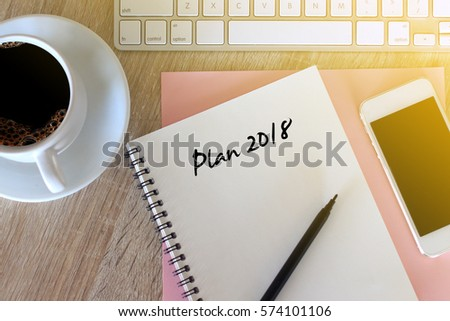 Business concept - Top view notebook writing Plan 2018