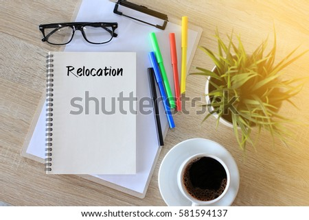 Business concept - Top view notebook writing Relocation