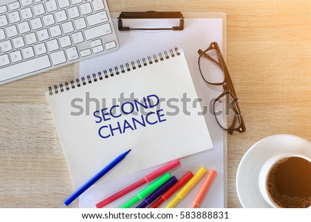 Business concept - Top view notebook writing SECOND CHANGE
