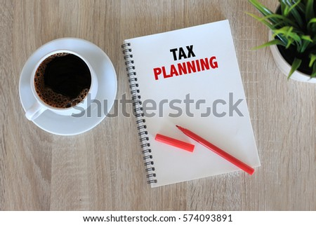 Business concept - Top view notebook writing Tax Planning