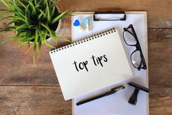 Business concept - Top view notebook writing TOP TIPS