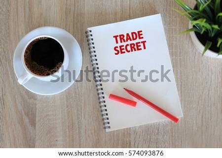 Business concept - Top view notebook writing Trade Secret