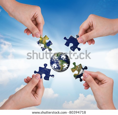 Business concept with a hand building puzzle globe #80394718