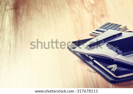 Business concept with agenda, smartphone and calculator. Copy space