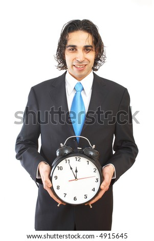 business concept with businessman holding an alarm clock