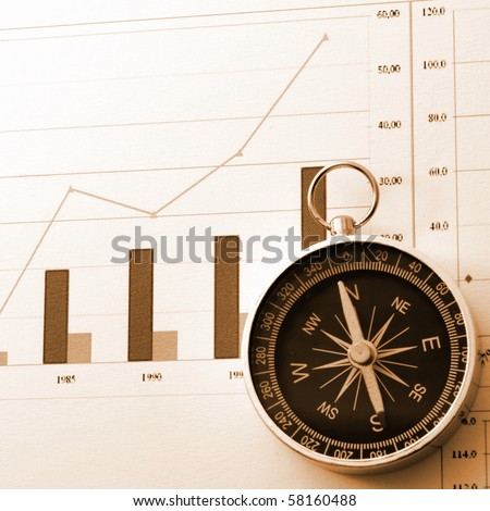 business concept with compass and diagram or chart