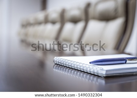 Business concept with empty meetingroom, paper agenda and pen. vintage tone Stock photo ©