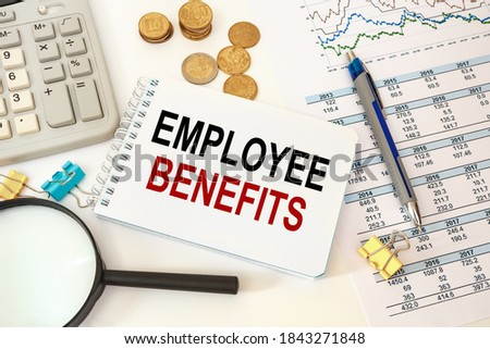 Business concept - workspace office desk and notebook writing Employee benefits Photo stock ©