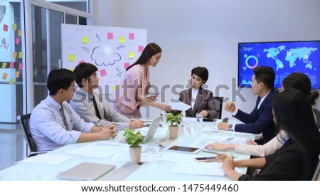 Business concept. Young businessmen are distributing documents to present their work. #1475449460