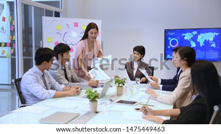 Business concept. Young businessmen are distributing documents to present their work. #1475449463