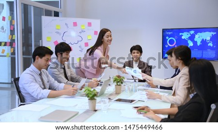 Business concept. Young businessmen are distributing documents to present their work. #1475449466