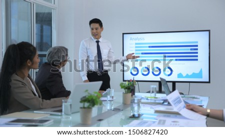 Business concept. Young men presenting results at the meeting. 4k Resolution.