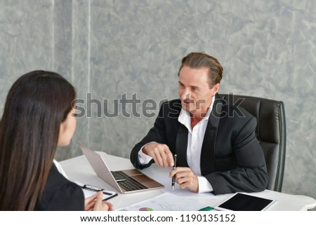 Business Concepts. Businessman is working in office. Business People work happily and relax. The businessmen are serious. Businessmen, they talk and communicate. #1190135152