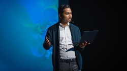 Business Conference Stage: Indian Tech Development Guru Presents Firm's Newest Product, He's Holding Laptop and Does Motivational Talk about Science, Technology, Software Development and Leadership