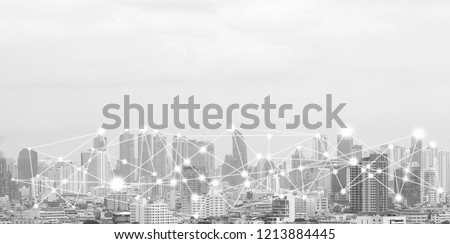 business connection in the city with digital graphic link network internet of things and information communication technology buildings black and white background