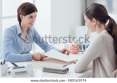 Business consultant and customer meeting in the office, the businesswoman is holding a contract and pointing #580163974