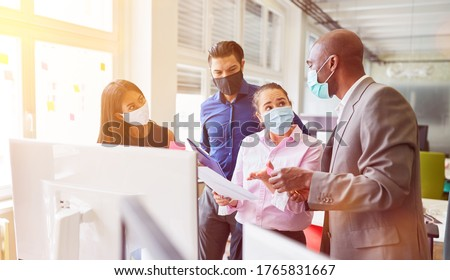 Business Consulting in Internet agency with face mask according to Covid-19 and coronavirus pandemic