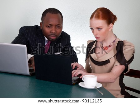 Business conversation between black man and redhead woman - series of photos