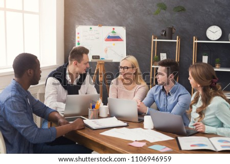 Business corporate meeting of multiethnic team. Young cheerful people brainstorming, discussing new startup project in office, copy space #1106946959