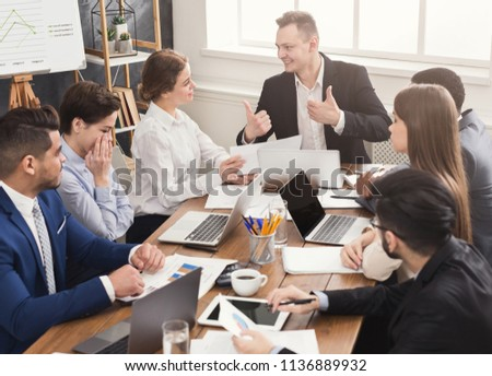 Business corporate meeting of successful team. Young cheerful people brainstorming, discussing new startup project in office, copy space #1136889932