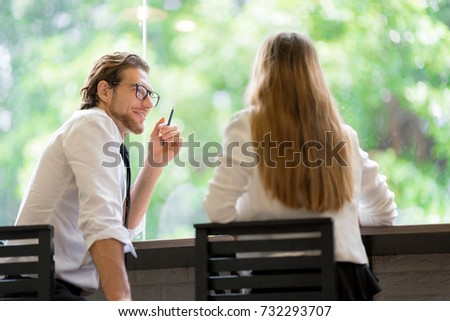 Business Corporate People Working Concept. Businessman is talking to encourage his friend for fight about work. He is fail in love with her.