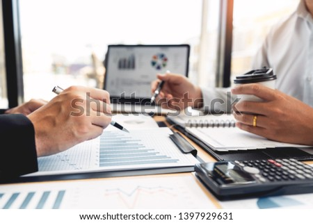 Business Corporate team brainstorming, Planning Strategy having a discussion Analysis investment researching with chart at office his desk documents and saving concept. #1397929631