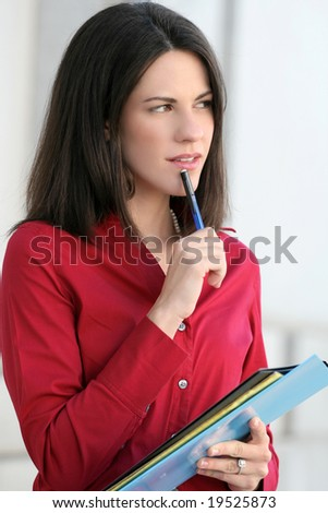 Business, corporate woman with folders, notepad and pencil, thinking about economic problems, outdoors