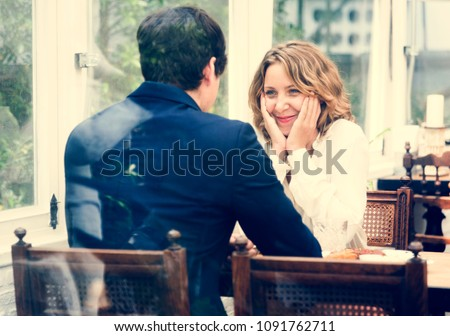 Business couple dating in the cafe