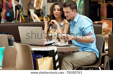 Business couple having lunch