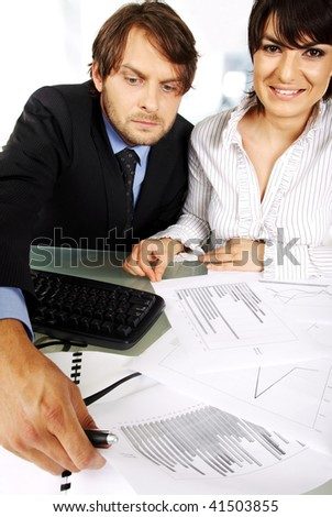 business couple is making an analyses looking at graphics